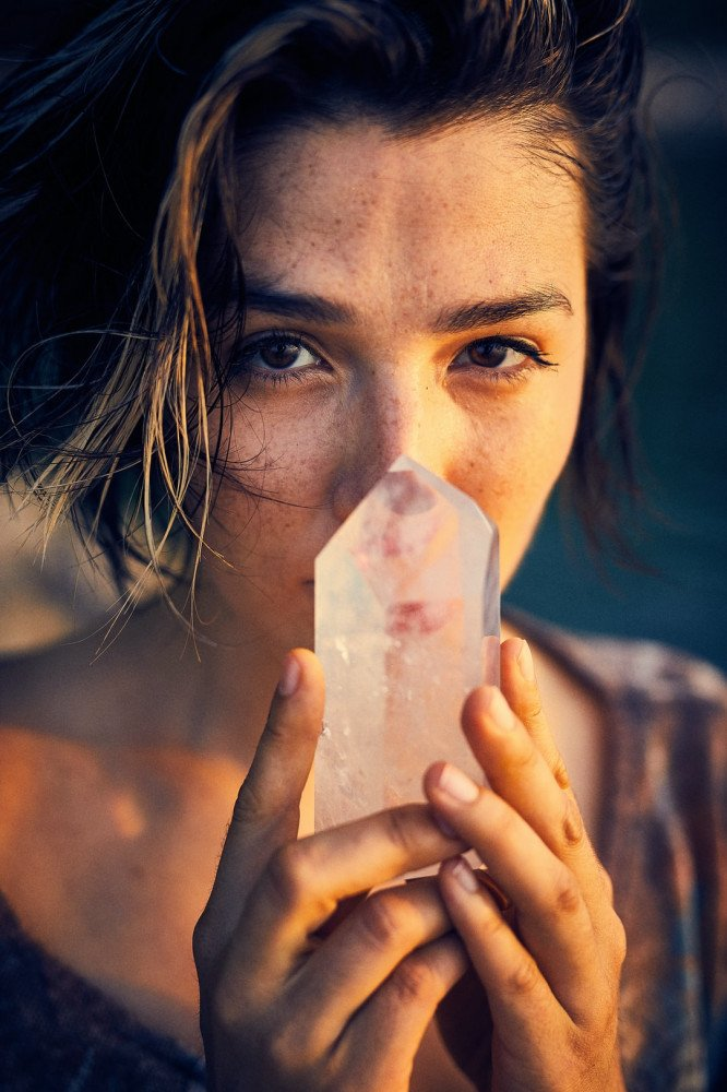 Woman holding clear quartz