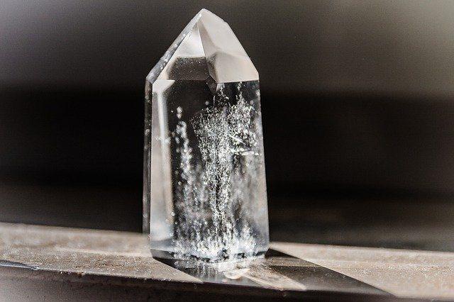 Clear quartz in sunlight on a dark background