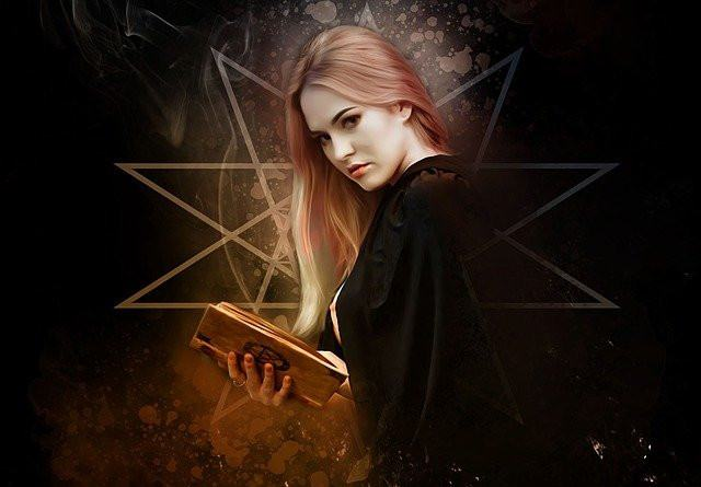 Witch holding a book of shadows