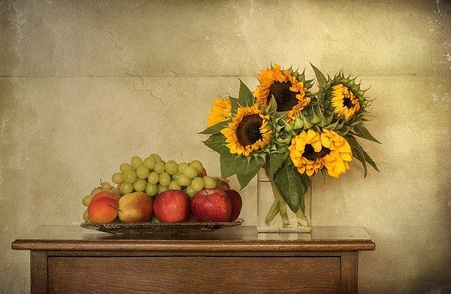 Lammas harvest of sunflowers, grapes, and fruit